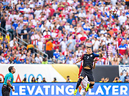 U.S forward Bobby Wood jumps for the header as referee Julio Bascuñan of Chile watches him go during a Copa America Centenario group stage matchup at Lincoln Financial Field in Philadelphia on Saturday June 11, 2016. The U.S. defeated Paraguay 1-0.