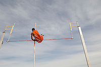 Pole vaulted in mid-air, low angle view