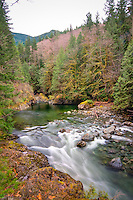 The south fork of the Snoqualmie River rushes out of the Cascade Mountains about 30 miles east of Seattle, Washington on a chilly winter day.