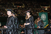 Jennie Daniels receives her MBA at graduate commencement. Photo by Ben Siegel