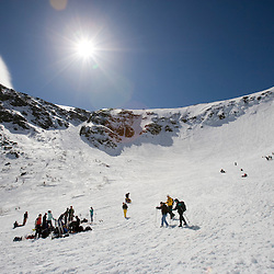 Skiers in Tuckerman Ravine in New Hampshire's White Mountains. White Mountain National Forest. April.