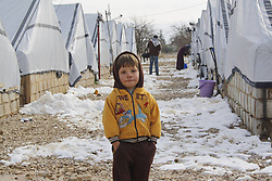 60823367  <br /> A child stands in the snow at a refugee camp in Bekaa Valley, in eastern Lebanon, after a snowstorm on Dec. 12, 2103. The snow storm Alexa struck Lebanon Tuesday night, bringing snow to higher areas and torrential rain elsewhere, accompanied by high winds.The United Nations and its humanitarian partners are ramping up aid efforts for the more than 800,000 Syrian refugees in Lebanon who were shivering through rains, snowfall and freezing temperature as a fierce winter storm moves across the region, UN officials said here Friday., Thursday, 12th December 2013. Picture by  imago / i-Images<br /> UK ONLY