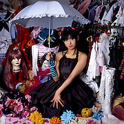 """Fujiwara Natsuki 23, born in Hokkaidō, the most northern island in the Japanese archipelago, moved to Tokyo and became a """"talent,"""" or model / media personality. She lives alone and avoids talking about her family or past. She is also a cosplayer who makes her own costumes and has collected some 100 outfits."""