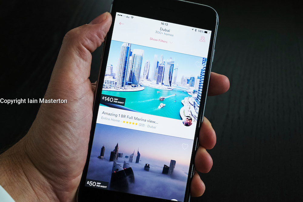 Airbnb holiday room booking app showing apartment in Dubai for rent on an iPhone 6 plus smart phone