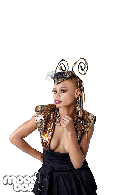 Portrait of young African American woman with fashionable headdress over white background