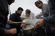 A group of migrants cooking on in the Grande Synthe refugees camp,  France. FEDERICO SCOPPA/CAPTA