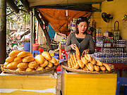 02 APRIL 2012 - HANOI, VIETNAM: A woman sells baguettes at the Long Bien Station in Hanoi, the capital of Vietnam. Baguettes are one of influences left by the French colonialists.    PHOTO BY JACK KURTZ