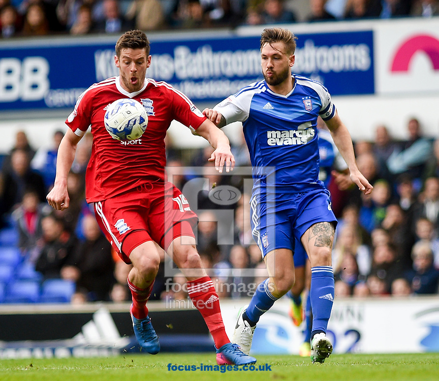 Luke Chambers of Ipswich Town and Lukas Jutkiewicz of Birmingham City battling for the ball during the Sky Bet Championship match at Portman Road, Ipswich<br /> Picture by Hannah Fountain/Focus Images Ltd 07814482222<br /> 01/04/2017