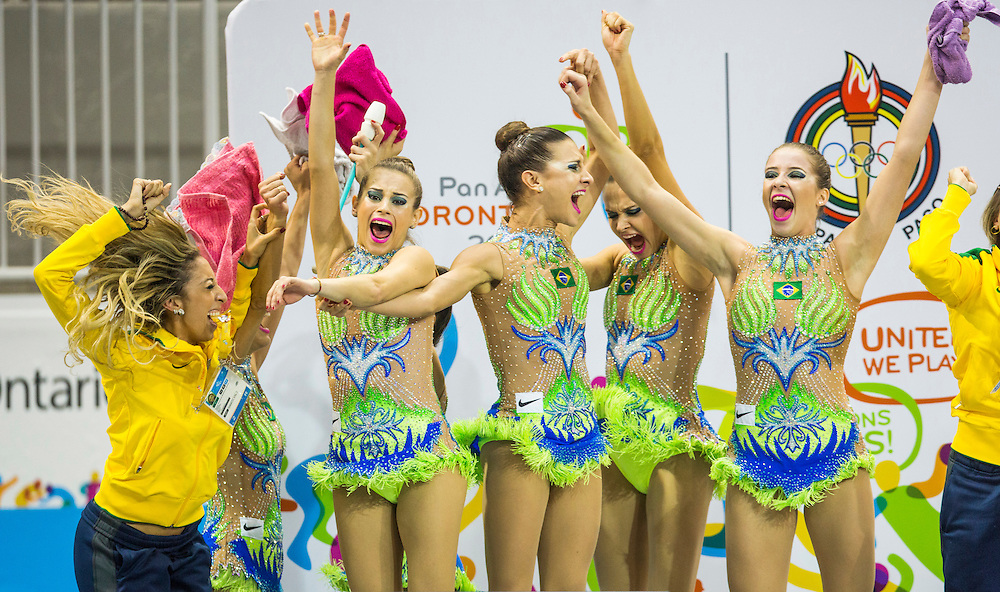 Brazil's group all-around team celebrate after winning fold following the rhythmic gymnastics clubs and hoops routine, at the Pan Am Games in Toronto, Saturday July 18, 2015.    THE CANADIAN PRESS/Mark Blinch