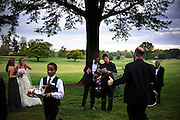 photo by Matt Roth.Saturday, April 14, 2012.Assignment ID: 30124225A..Lead wedding photographer Geoff Chesman, middle right, plans the family portrait session with groom Lee Cowan, middle left, at the reception held at the Chevy Chase Club in Washington D.C. Saturday, April 14, 2012. Bride Molly Spencer Palmer, left, talks with her sister Hope Palmer. Lee's father, Dr. Leland Cowan, far right, stands with his wife Constance Cowan (obscured, in wheelchair), while secondary wedding photographer Kristian Thacker carries a chair for Constance to sit in...Molly Palmer, 29, and Lee Cowan, 46, were colleagues at NBC News, but it wasn't until The Balloon Boy story coverage in 2009 that their romance sparked.