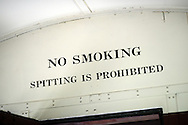 """LANSDALE, PA - AUGUST 24: A """"No Smoking"""" or spitting sign is seen aboard the New Hope and Ivyland Railroad during Founders Day August 24, 2013 in Lansdale, Pennsylvania. The New Hope and Ivyland Railroad made special trips as part of Founders Day from Lansdale to Souderton. (Photo by William Thomas Cain/Cain Images)"""