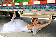 MR. Model relased photo. Ballerina fixing a bus with ballet shoes and a white dress.