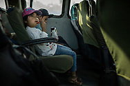 Zapotec children on the bus from Tlacolula to San Miguel del Valle eating junk food.  Since the implementation of NAFTA (North American Free Trade Agreement) in 1994, sugary drinks and junk food imported from the United States has flooded the Mexican market and changed the diet of most Mexican.  Obesity has reached crisis levels but, at the same time, malnutrition rates in 7 Mexican states, including Oaxaca exceed 36%.  Malnutrition bear down hardest on indigenous communities like the Zapotec.