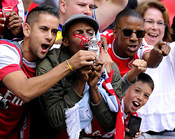 Arsenal fans celebrate with a mini FA Cup after seeing their side win the community shield  - Photo mandatory by-line: Joe Meredith/JMP - Mobile: 07966 386802 10/08/2014 - SPORT - FOOTBALL - London - Wembley Stadium - Arsenal v Manchester City - FA Community Shield