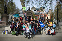 © Licensed to London News Pictures. 18/04/2019. London, UK. Protesters arriving from Scotland gather around a statue of suffragist leader Millicent Fawcett in Parliament Square, as protestors from Extinction Rebellion occupy the area for a fourth day. Protesters are demanding urgent government action on climate change. Photo credit: Ben Cawthra/LNP