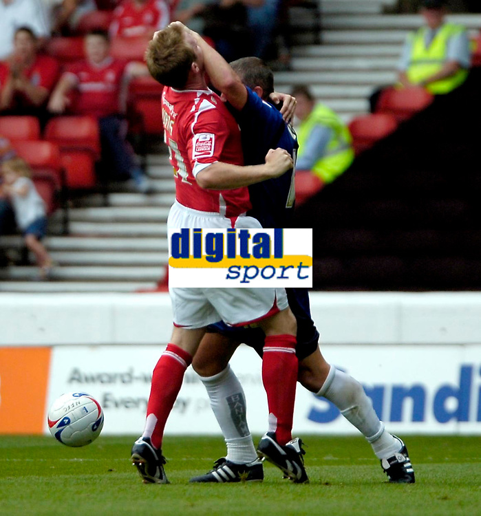 Photo: Ed Godden.<br />Nottingham Forest v Bradford City. Coca Cola League 1.<br />05/08/2006. John Curtis (L) and Bradford's Dean Windass have an off-the-ball clash.
