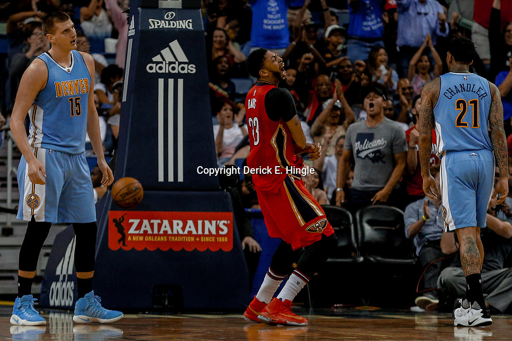 Apr 4, 2017; New Orleans, LA, USA; New Orleans Pelicans forward Anthony Davis (23) reacts after a dunk over Denver Nuggets forward Nikola Jokic (15) during the second quarter of a game at the Smoothie King Center. Mandatory Credit: Derick E. Hingle-USA TODAY Sports