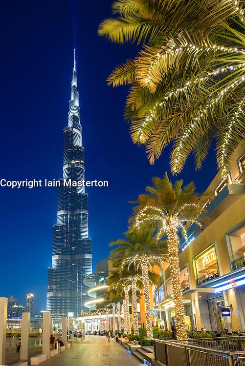 Evening view of Burj Khalifa tower and Dubai Mall shopping centre in Dubai United Arab Emirates
