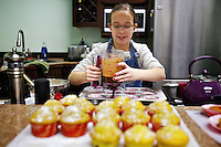 Caitlyn Hager, 10, prepares her chocolate cupcakes for baking Friday during a cooking demonstration at Chef's Heaven in Dalton Gardens. Hager has been baking since she was 5 under the tutelage of her grandmother.