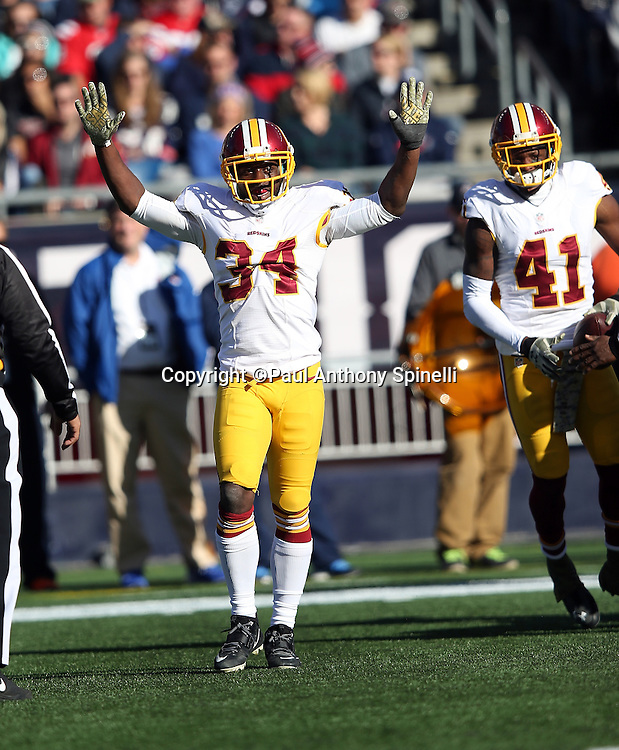 Washington Redskins strong safety Trenton Robinson (34) celebrates after Washington Redskins cornerback Will Blackmon (41) recovers a first quarter fumble by the New England Patriots during the 2015 week 9 regular season NFL football game against the New England Patriots on Sunday, Nov. 8, 2015 in Foxborough, Mass. The Patriots won the game 27-10. (©Paul Anthony Spinelli)