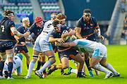 Stuart McInally (#2) of Edinburgh Rugby is tackled during the 1872 Cup second leg Guinness Pro14 2019_20 match between Edinburgh Rugby and Glasgow Warriors at BT Murrayfield Stadium, Edinburgh, Scotland on 28 December 2019.