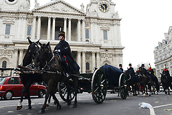 © Licensed to London News Pictures.30?11/2013. London, UK. Sacred soil from the battlefields of Flanders has been carried on a gun carriage by St Paul's Cathedral. The soil arrived yesterday on a Belgian frigate and was loaded on to a gun carriage this morning. The gun carriage was drawn by six colour matched black Irish Draught horses and was taken to Wellington Barracks.Photo credit : Peter Kollanyi/LNP