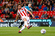 Stoke City midfielder Joe Allen (4) plays the ball forward during the EFL Sky Bet Championship match between Stoke City and Swansea City at the Bet365 Stadium, Stoke-on-Trent, England on 18 September 2018.