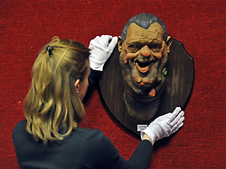 © Licensed to London News Pictures. 08/12/2011, London, UK. A Bonhams employee straightens a puppet from satirical television programme Spitting Image of newspaper proprietor Robert Maxwell. The Puppet is expected to fetch 300-400 GBP.  Bonhams, London, photocall for entertainment memorabilia today, 8th December 2011.  The auction takes place on Thursday 15th December. Photo credit : Stephen Simpson/LNP