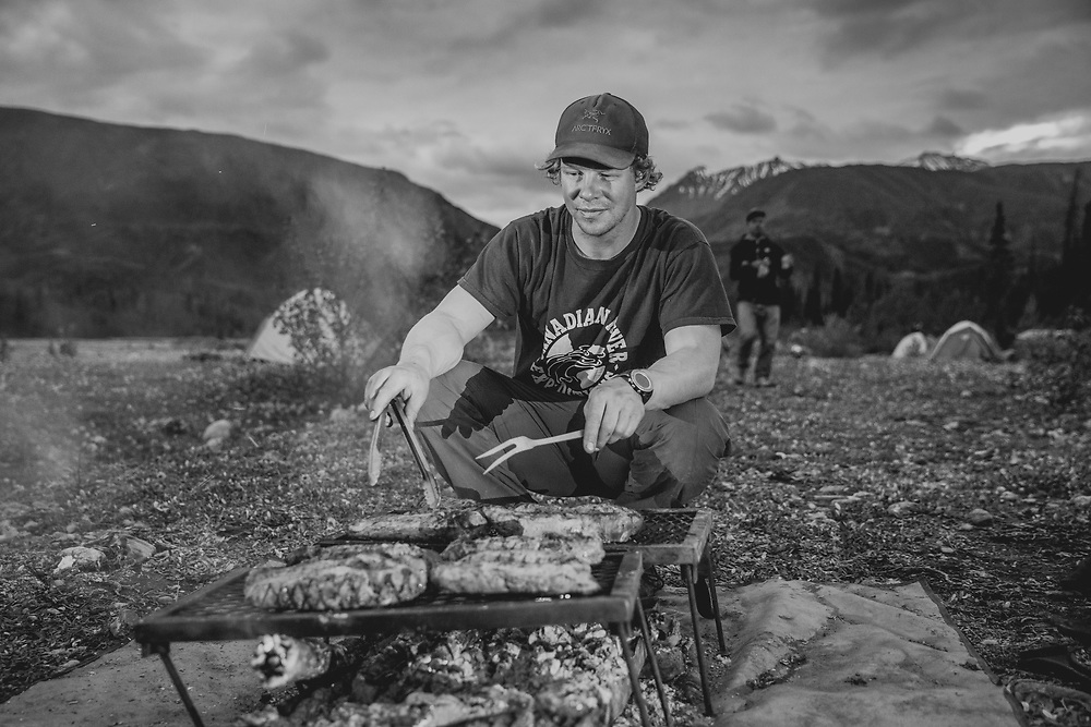 Brad Goodwin, one of our 5 river guides prepares dinner in the Tatshenshini-Alsek Provincial Park in British Columbia, Canada on September 2, 2016.