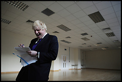 London Mayor Boris Johnson going through his notes for his rally with Prime Minister David Cameron in Orpington, London, during the Mayoral Campaign, London, UK,  April 18, 2012. Photo By Andrew Parsons / i-Images.