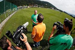 """24.07.2015, Sportplatz, Walchsee, AUT, Trainingslager, FC Augsburg, im Bild Stefan Reuter (Geschaeftsfuehrer Sport FC Augsburg), Interview auf dem Trainingsplatz, im Hintergrund das Mannschaftshotel """"Seehof"""", Foto: Eibner // during the Trainingscamp of German Bundesliga Club FC Augsburg at the Sportplatz in Walchsee, Austria on 2015/07/24. EXPA Pictures © 2015, PhotoCredit: EXPA/ Eibner-Pressefoto/ Krieger<br /> <br /> *****ATTENTION - OUT of GER*****"""