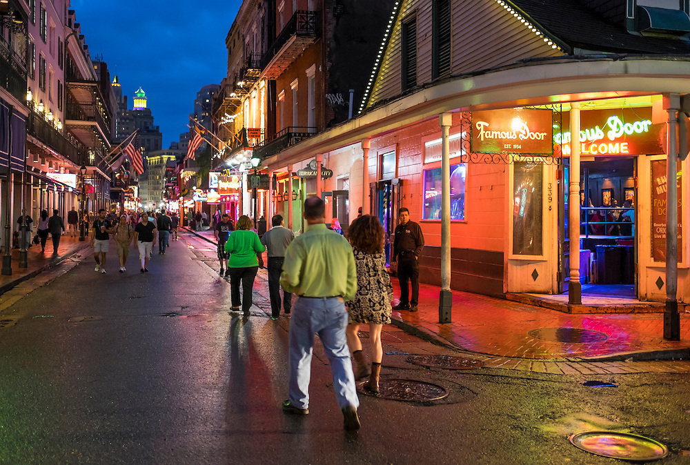 NEW ORLEANS - CIRCA FEBRUARY 2014: People walking in Bourbon Street in the New Orleans French Quarter during the Mardi Gras celebrations at night.