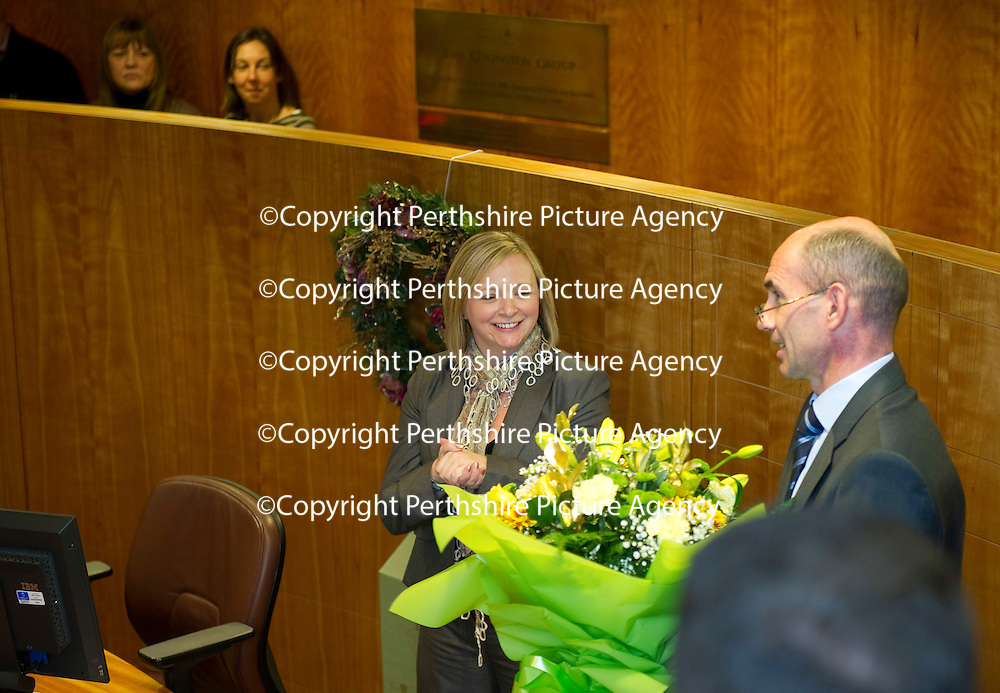 Edrington Achievement Awards....15.12.11<br /> Chief Exec Ian Curle presents flowers to organiser Dawn Taylor<br /> Picture by Graeme Hart.<br /> Copyright Perthshire Picture Agency<br /> Tel: 01738 623350  Mobile: 07990 594431