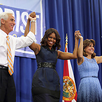 "Democrat Charlie Crist, First Lady Michelle Obama and Annette Taddeo celebrate after the ""Commit to Vote"" rally for Democrat Charlie Crist who is running for Governor of the state of Florida. The campaign called on the event to "" energize voters and lay out the stakes for Floridians in the critical election on November 4th."" at the Barnett Park Gymnasium in Orlando, Florida on Friday, Nov. 17, 2014. (AP Photo/Alex Menendez)"
