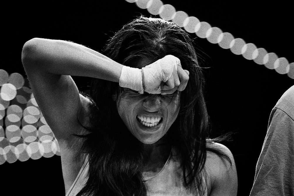 After fighting against June Chin, 24, from Gleason's Gym, Cara Castronova, 25, from Team Freeform, is about to learn that she has won the 119-pound women's final of the 2005 Daily News Golden Gloves at the Theatre of Madison Square Garden on April 8th.