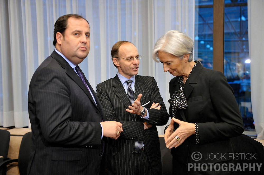 Luc Frieden, Luxembourg's finance minister, center, speaks with Christine Lagarde, France's finance minister, right, and Josef Proell, Austria's finance minister, left, during the Eurogroup meeting in Brussels, Belgium, on Monday, Feb. 15, 2009. (Photo © Jock Fistick)