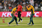 Imran Tahir of South Africa celebrates with teammates FAF du Plessis after taking a wicket of John Hastings of Australia during the 2016 T20 International Series match between South Africa and Australia in Kingsmead Stadium Durban, Kwa-Zulu Natal on 04 March 2016©Muzi Ntombela/Backpagepix