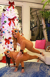 "Coco Austin releases a photo on Twitter with the following caption: """"...and of course my sister made me get in some kinda of yoga pose in our reindeer outfits(we do this every time we see each other)<br /> #lizardpose <br /> #christmas2018"""". Photo Credit: Twitter *** No USA Distribution *** For Editorial Use Only *** Not to be Published in Books or Photo Books ***  Please note: Fees charged by the agency are for the agency's services only, and do not, nor are they intended to, convey to the user any ownership of Copyright or License in the material. The agency does not claim any ownership including but not limited to Copyright or License in the attached material. By publishing this material you expressly agree to indemnify and to hold the agency and its directors, shareholders and employees harmless from any loss, claims, damages, demands, expenses (including legal fees), or any causes of action or allegation against the agency arising out of or connected in any way with publication of the material."