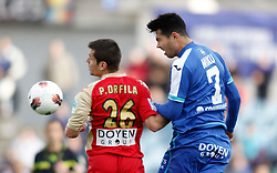 07.04.2012, Stadion Coliseum Alfonso Perez, Getafe, ESP, Primera Division, FC Getafe vs Sporting Gijon, 32. Spieltag, im Bild Getafe's Miku against Sporting de Gijon's Pedro Orfila // during the football match of spanish 'primera divison' league, 32th round, between FC Getafe and Sporting Gijon at Coliseum Alfonso Perez stadium, Getafe, Spain on 2012/04/07. EXPA Pictures © 2012, PhotoCredit: EXPA/ Alterphotos/ Alvaro Hernandez..***** ATTENTION - OUT OF ESP and SUI *****