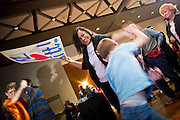 28 FEBRUARY 2012 - PHOENIX, AZ:     SISI HINGANO, from Gilbert, AZ, dances with a young Mitt Romney supporter during a primary election watch party in Phoenix. Several hundred Romney supporters crowded into a ballroom in a Phoenix hotel to watch primary results from Michigan and Arizona. Romney won the night, scoring a tight win in the Michigan Republican Presidential primary and a comfortable win in the Arizona Republican Presidential primary. PHOTO BY JACK KURTZ