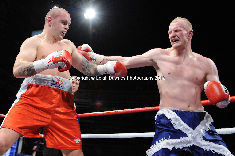 Gary Cornish (blue shorts) defeats Reigijus Ziausys in a Heavyweight contest at Olympia, Liverpool on the 21st January 2012. Frank Maloney Promotions on Skysports HD1. © Leigh Dawney Photography 2012.