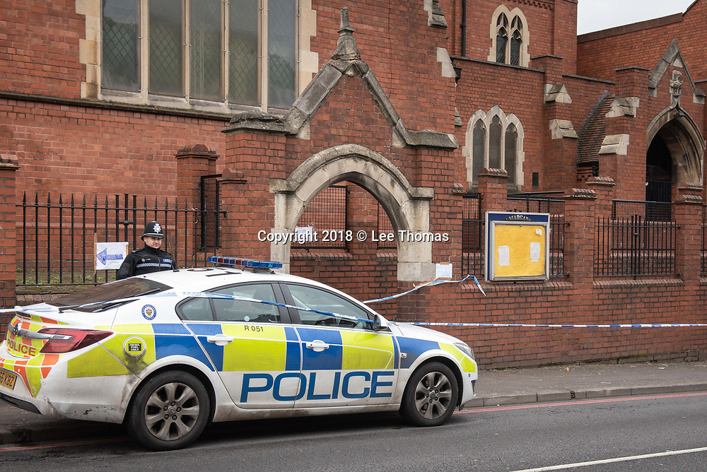 Walgrave Road, Coventry, West Midlands, UK. 8th April 2018. A woman is critical  after being stabbed outside a church in Coventry. The woman, believed to be in her 30s, suffered wounds to the stomach in the attack outside St Margaret's Church Walgrave Road, Coventry. Police have sealed off an area around the entrance to the church in the West Midlands city. // Lee Thomas, Tel. 07784142973. Email: leepthomas@gmail.com  www.leept.co.uk (0000635435)