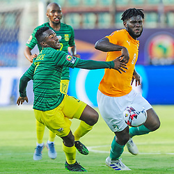 Franck Kessie of Ivory Coast turns away from Lebohang Maboe of South Africa during the 2019 Africa Cup of Nations Finals game between Ivory Coast and South Africa at Al Salam Stadium in Cairo, Egypt on 24 June 2019  <br /> Photo : Icon Sport