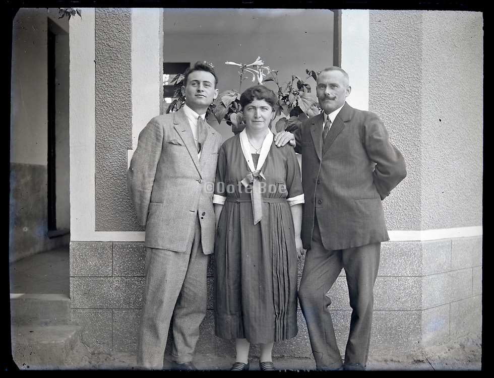 adult son posing with parents France circa 1930s