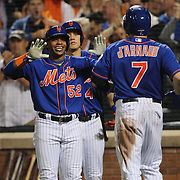Yoenis Cespedes, New York Mets, congratulates Travis d'Arnaud on his two run home run during the New York Mets Vs Los Angeles Dodgers, game three of the NL Division Series at Citi Field, Queens, New York. USA. 12th October 2015. Photo Tim Clayton for The Players Tribune