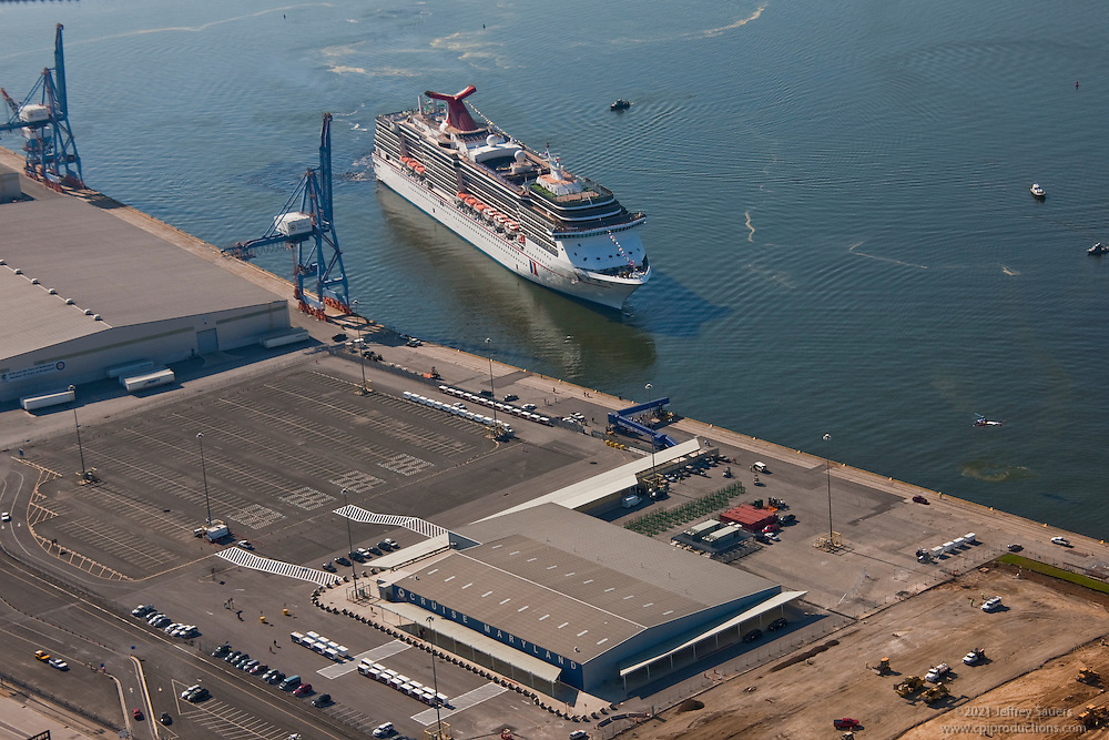 Aerial image of Maryland Cruise terminal at the Port of Baltimore with the cruise ship Carnival Pride passing South Locust Point