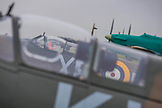 Supermarine Spitfires on the standing area with Harker Hurricanes - Duxford Battle of Britain Air Show taking place during IWM (Imperial War Museum) Duxford's centenary year. Duxford's principle role as a Second World War fighter station is celebrated at the Battle of Britain Air Show by more than 40 historic aircraft taking to the skies.