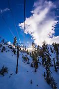 Ski lift and sunstar, Alpine Meadows ski area, Squaw Valley, California