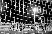 SINGAPORE, SINGAPORE - AUGUST 31: (EDITOR'S NOTE: This image has been converted to black and white) Hassan Sunny of Singapore dives for the the ball during Singapore vs Hong Kong international friendly match at the Jalan Besar Stadium on August 31, 2017, in Singapore, Singapore. (Photo by Getty Images)