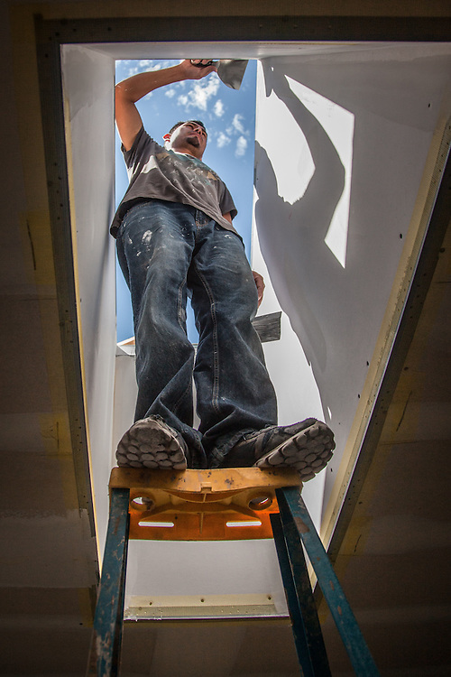 Jorge muds skylight wells during the remodel of the School Street home in Calistoga.